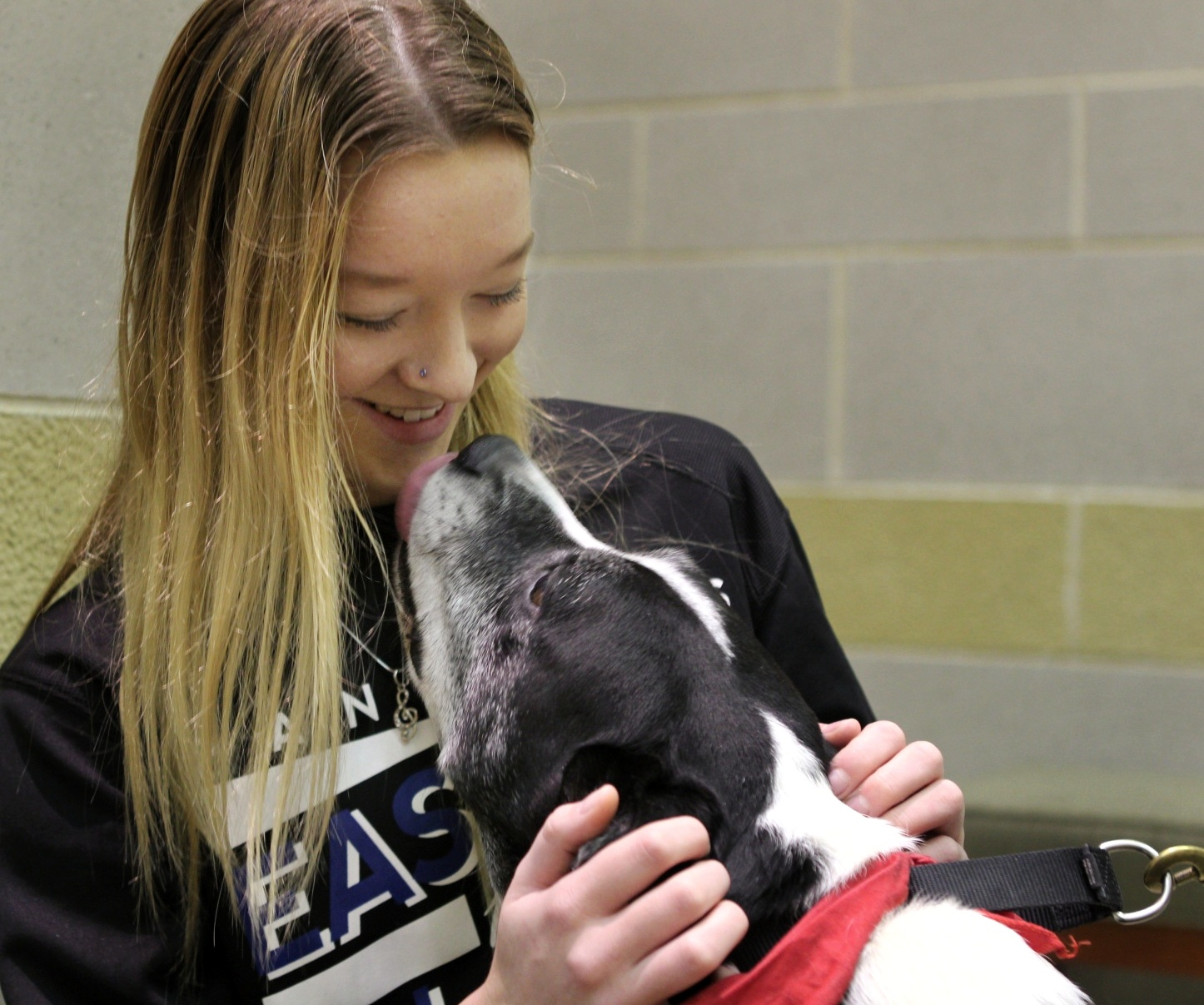 Allyson Turner, a sophomore majoring in environmental biology, pets the therapy dog, Wilson, at Booth Library Monday evening. Turner says her stress levels go down every time she sees a dog because she just loves dogs so much.