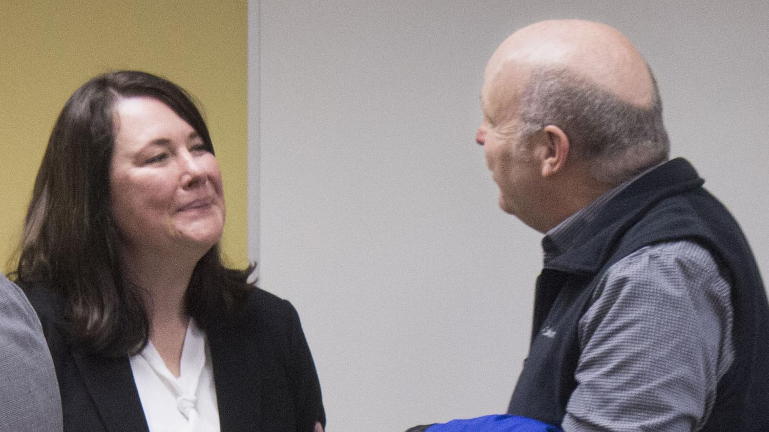 Linda Amundson; a candidate for the dean of the college of education; talked with Director of Housing Mark Hudson after an open session interview Tuesday morning.