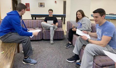 A group of students organize for a Bible study through Campus Outreach on Thursday night in the Andrews Hall basement. There were about 40 students in attendance Thursday for the group's large meeting. The students meet for Bible studies at different locations every week in smaller groups.