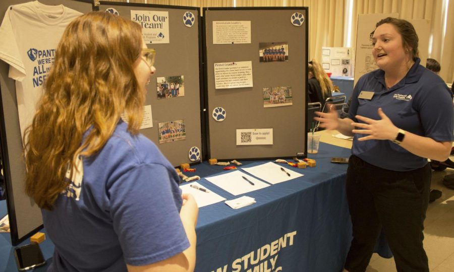Jaclyn Thomas (left), an early childhood and elementary education sophomore, and Katie Gray (right), an early childhood and middle level education senior, discuss being in the New Student and Family programs during the Student Involvement Fair on Wednesday afternoon.
