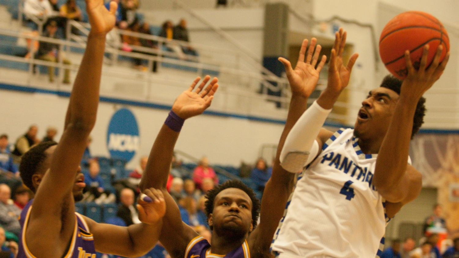 Eastern guard Marvin Johnson attempts a layup against Tennessee Tech Jan. 18 at Lantz Arena. Johnson had six points and four assists in an 84-59 win for the Panthers.