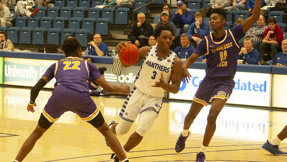 Junior guard Mack Smith drives past two defenders to the rim in Eastern's 84-59 win against Tennesse Tech on Jan. 18 at Lantz Arena.