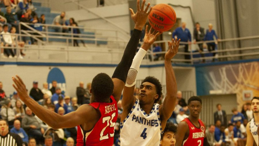 Eastern guard Marvin Johnson rises up over a defender to attempt a shot against Southeast Missouri Jan. 25 in Lantz Arena. The Panthers won the game 61-59.