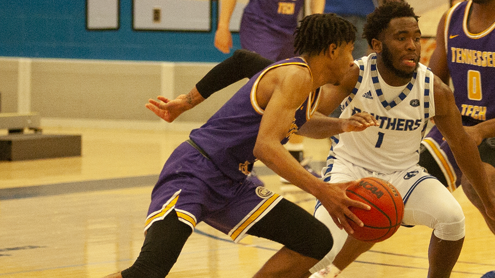 Junior guard Kashawn Charles tightly pressures the ball handler in Eastern's 84-59 win against Tennessee Tech on Jan. 18 at Lantz Arena.