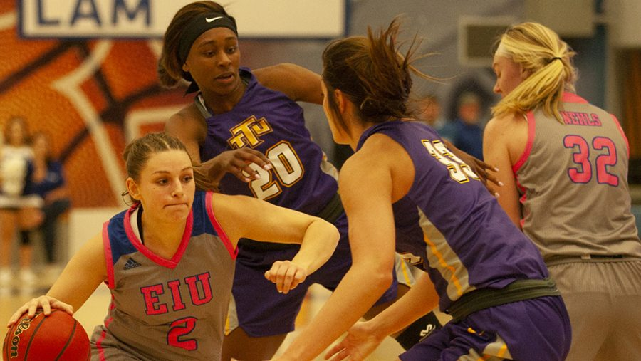 Karina Delgado | The Daily Eastern News Jordyn Hughes tries to drive past a defender as Jennifer Nehls sets a screen for her. Eastern lost 75-62 to Tennessee Tech Jan. 18 in Lantz Arena.