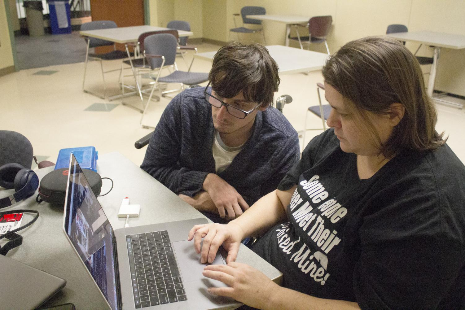 Mary Ellen Greenburg, a senior television film production major, and Timothy Russell, a television film production major, work on a video project on Adobe Premiere for their Genres class Wednesday night.