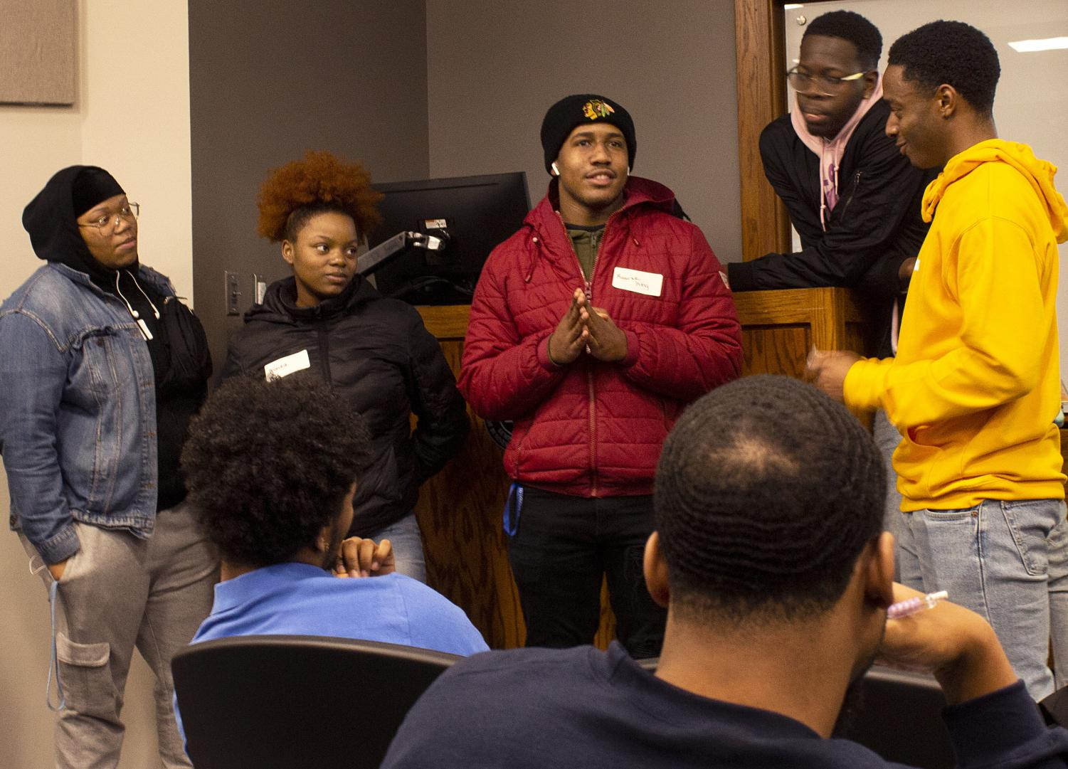 Joshua Ware, an applied engineering and tech major, questions the BSU team during the Family Feud: Black and Blue edition, hosted by S.T.R.O.N.G mentoring, in Lumpkin Auditorium on Tuesday night. Full coverage on page three.