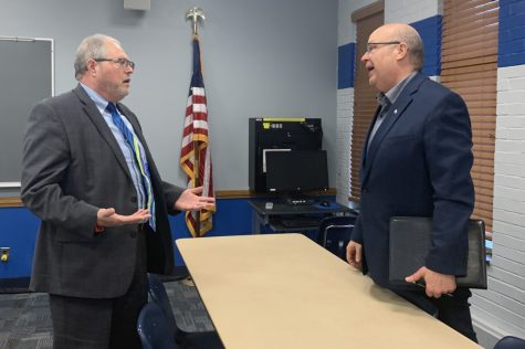 Philip Peña (left), a candidate for the Vice President of Business Affairs, and Mark Hudson (right), director of Housing and Dining, talk after the open session for the Vice President of Business Affairs search Wednesday afternoon.