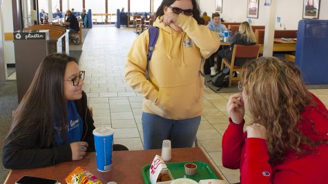 Luz Stanislawek (left), freshman pre physical therapy major, Brianna King (middle), a freshman criminology major, and Margaret McNellis, a freshman special education major, enjoy lunch together on Thursday afternoon at the Food Court in the Martin Luther King Jr. University Union. King decided to stop by at the lunch table after seeing Stanislawek and McNellis eating lunch.