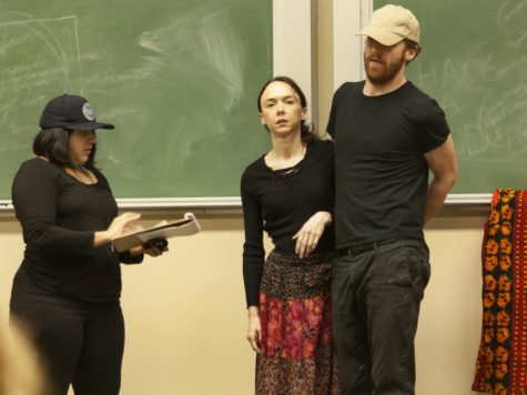 "Debbie Banos, Katherine Bellantone and Nathaniel Smith, all members of the Still Point group, perform a play called ""The True Cost,"" based on real stories of human trafficking, at Buzzard Auditorium Thursday.  Still Point is based in Chicago."