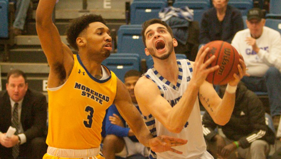 Eastern guard Josiah Wallace drives under the basket against Morehead State on Feb. 8 in Lantz Arena. Wallace had 25 points in the game, which the Panthers won 71-65.