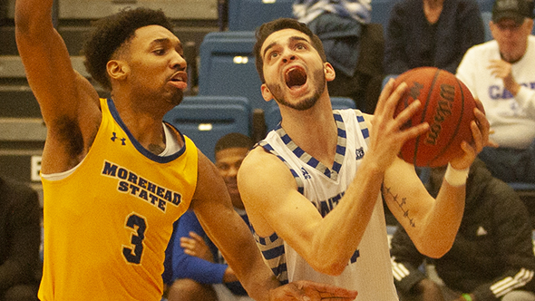 Eastern guard Josiah Wallace drives around a Morehead State defender on Feb. 8 in Lantz Arena. Wallace had 25 points in a 71-65 win.