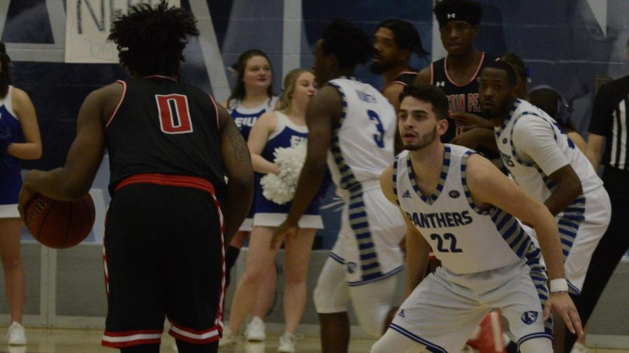 Eastern guard Josiah Wallace defends an Austin Peay defender on Feb. 22 in Lantz Arena. The Panthers won the game 83-80 in overtime and Wallace scored 23 points.