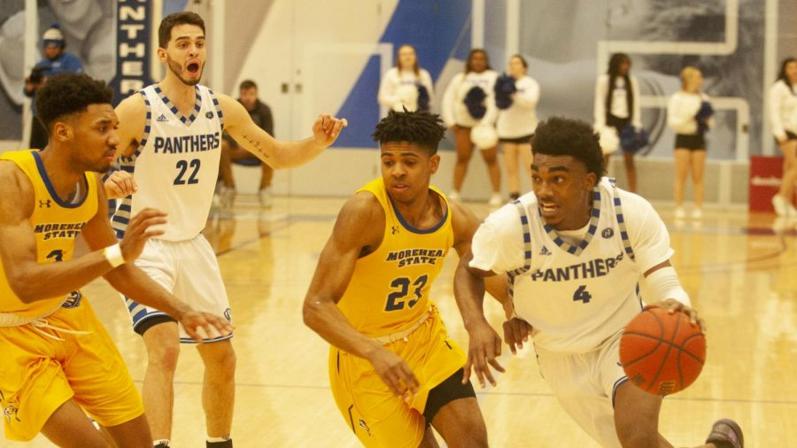 Eastern+guard+Marvin+Johnson+drives+to+the+basket+against+Morehead+State+on+Feb.+8+in+Lantz+Arena.+Johnson+had+seven+points%2C+two+rebounds+and+two+assists+in+the+game%2C+which+the+Panthers+won+71-65.
