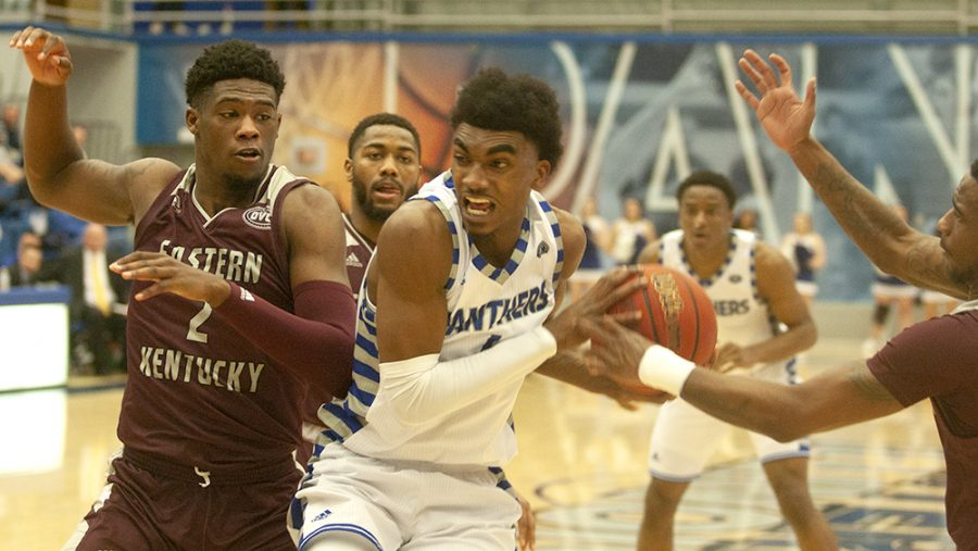 Eastern's Marvin Johnson drives through two Eastern Kentucky defender in the Panthers' 91-84 loss to the Colonels Thursday night in Lantz Arena. The Panthers are now just 4-7 in OVC play.