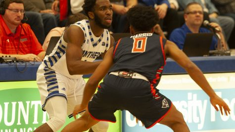 JJ Bullock | The Daily Eastern News Kashawn Charles maintains his dribble as he is guarded on the wing during Eastern's 95-83 victory over Tennessee-Martin Jan. 23 in Lantz Arena. The Panthers host third-place Eastern Kentucky Thursday in Lantz Arena.