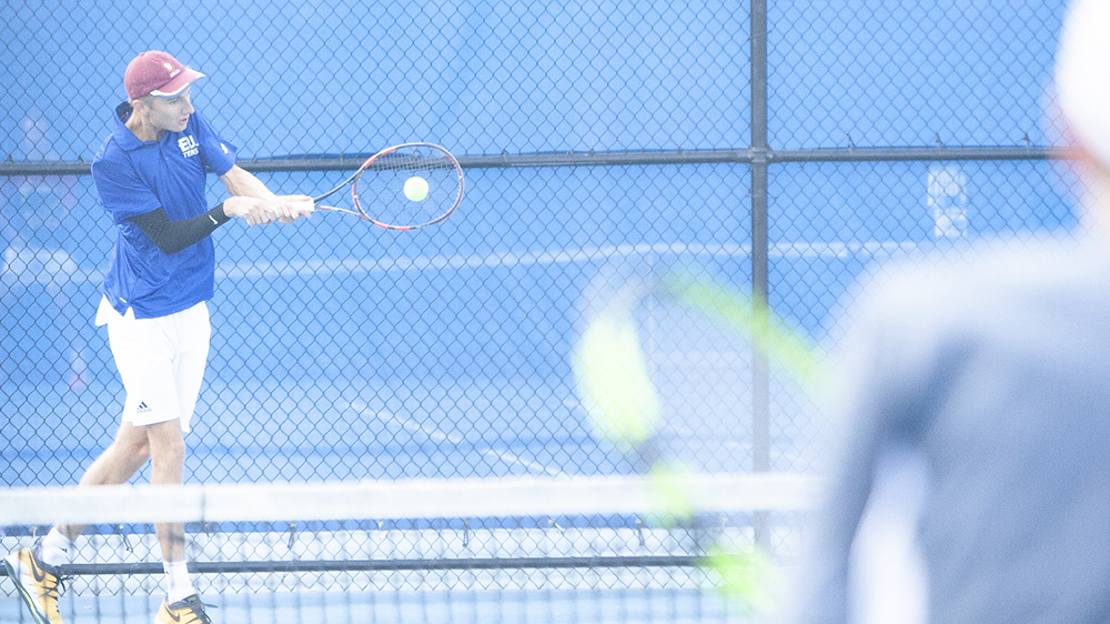File Photo | The Daily Eastern News Max Pilipovic-Kljajic reaches out to nail a backhand return to his opponent. Eastern takes on Northern Kentucky Friday and hopes to end a losing skid.