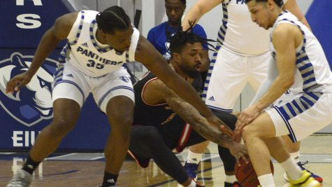 George Dixon (left), Logan Koch (middle) and Shareef Smith (right) surround an Austin Peay ball handler and reach in for a steal during Eastern's 83-80 victory over Austin Peay Feb. 22 in Lantz Arena. Eastern can secure an OVC tournament spot with a win Thursday against Southeast Missouri.