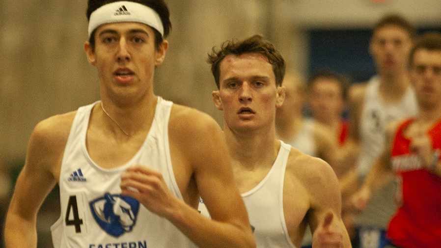 Karina Delgado | The Daily Eastern News Marcus Skinner (left) and Dustin Hatfield (right) lead a pack of runners together during a distance event at the EIU John Craft Invite Jan. 18 in the Lantz Field House. Eastern's track and field program competes at the Grand Valley State Big Meet Friday.
