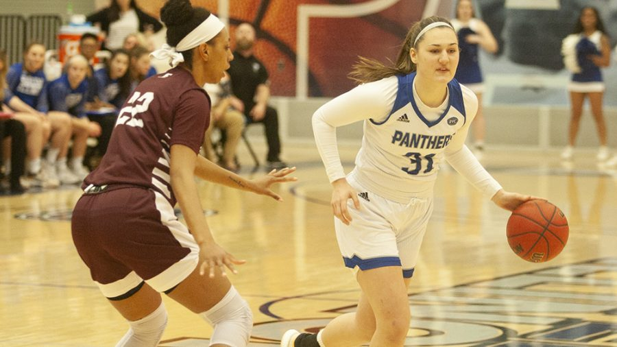 Eastern freshman guard Morgan Litwiller dribbles around a defender in the Panthers' 85-38 win over Eastern Kentucky Thursday night in Lantz Arena. Litwiller scored 16 points in the win.