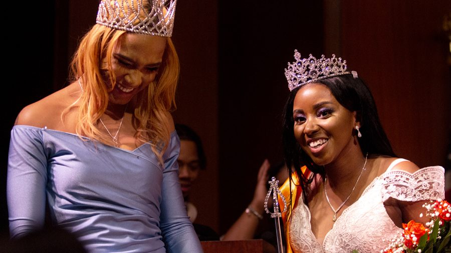 Latricia Booker, a junior majoring in pre-nursing and Miss Black EIU 2019, and Mikayla Sanford, a biological science major, celebrates together after Sanford's crowing as Miss Black EIU 2020 in the Grand Ballroom in the Martin Luther King Jr. University Student Union on Saturday night. The two took several photos together as the previous and currently reigning queens.