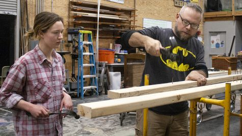 Emma Walker, a senior theatre arts major, and Christopher Gadomski, a theatre arts professor, technical director, and scene shop foreman, remove nails from a board that was used in a previous show in the Doudna Fine Arts Center at the scene shop on Monday afternoon.