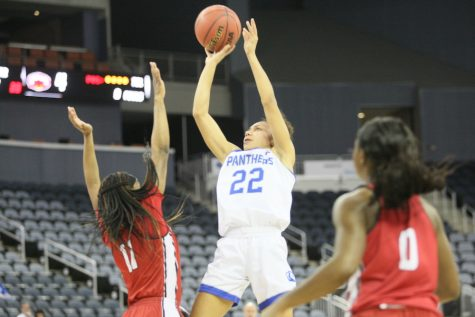 Dillan Schorfheide | The Daily Eastern News Lariah Washington rises above her defender for a shot attempt. Eastern defeated Jacksonville State 49-46 to advance to the semifinals Friday in the OVC Tournament.
