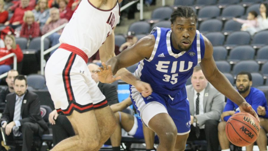 Eastern%E2%80%99s+George+Dixon+drives+around+an+Austin+Peay+defender+in+the+quarterfinals+of+the+OVC+Tournament+in+Evansville%2C+Indiana.+Dixon+had+15+points+and+12+rebounds+in+the+game%2C+which+the+Panthers+lost+76-65.