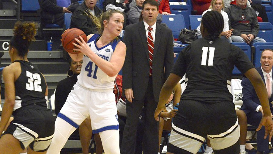 Abby+Wahl+looks+for+a+pass+with+a+couple+defenders+around+her.+Eastern+defeated+Austin+Peay+73-72+Feb.+22+in+Lantz+Arena.