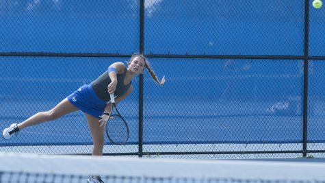 File Photo | The Daily Eastern News Claire Perez-Korinko serves the ball over the net to her opponent. Eastern's women's tennis team lost two matches over the weekend.