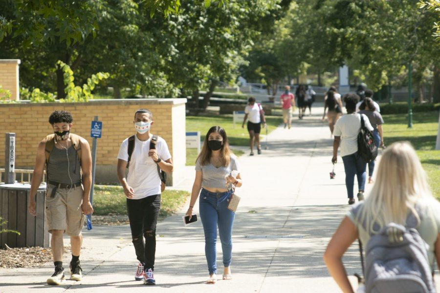 Students+walk+on+campus+this+afternoon+on+the+first+day+of+classes+for+the+Fall+2020+semester.+