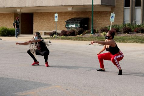 Cyan Carter (left), a Psychology, entrepreneurship, and human services sophomore and Lexi Smith (right) criminal justice sophomore break out some moves at Taylor Hall parking lot Tuesday afternoon.