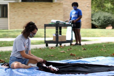 Harper Gerfen (left), a freshman geology  major, makes blankets while sitting in the North Quad on Wednesday afternoon.