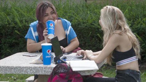 Felicia Gomez (left) a freshman education major and Jazmin Dally (right) a freshman education major enjoy their sodas while studying in front of Taylor Hall Tuesday evening.