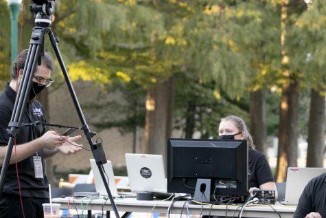 "Christian Hopper (left), a sophomore music education major, and Resa Fuller a senior music performance major, are ""getting ready for the live stream jazz concert"" Thursday night outside of Dounda Hall."