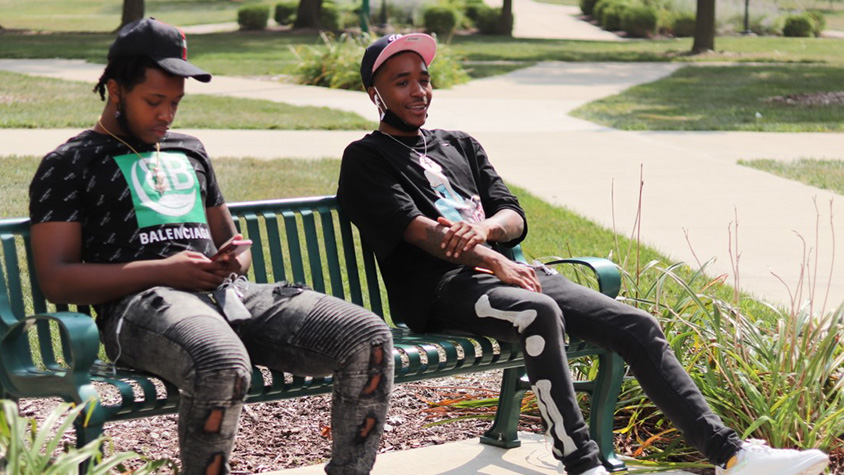 Ezavian Latham (right), a sophomore electric engineering major, sits with a friend on a bench between Lawson Hall and Andrews Hall on Thursday afternoon. The two were working on their music.