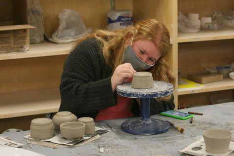 Elena Singleton, a junior art education major, makes a cup in Doudna Hall Thursday afternoon. Singleton said that the cup was for a ceramics class she is taking this semester.