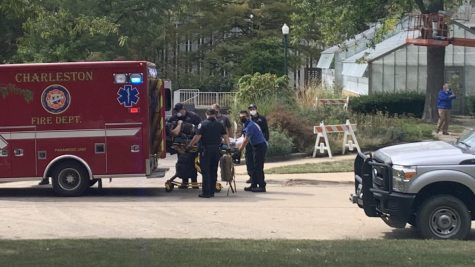 An Eastern employee is placed into an ambulance after falling from a motorized lift Wednesday afternoon.