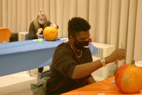 Frederick Davis, a sophomore video game production major, paints a pumpkin for the Pumpkin Paint & Sip event hosted in the University Ballroom. Students were provided a pumpkin and a painting kit to compete for 1st, 2nd, and 3rd place prizes.