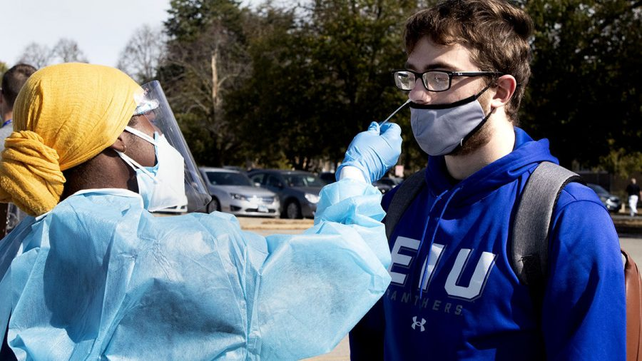 Ben Drake, a sophomore history teaching major, gets tested for COVID-19 at Eastern's flu shot and COVID-19 testing site at Lot W on Wednesday. Drake said he was getting tested to make sure that he did not have it and to keep his friends and family safe.