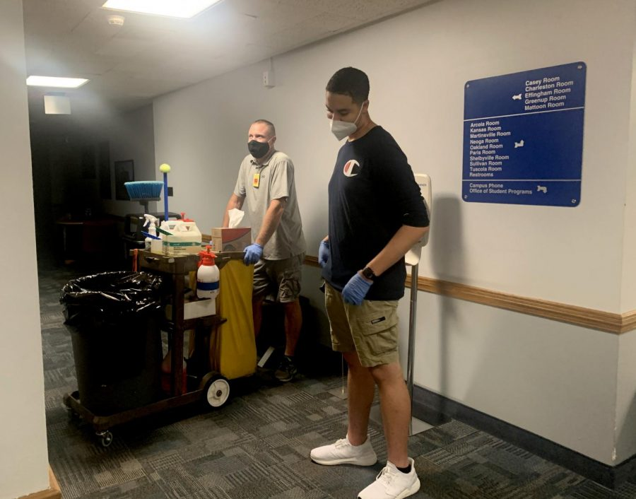 Joshua Hunt, a building service worker, and Jacob Williams, a computer and information technology senior, wait for the elevator to go down to the basement in the Martin Luther King Jr. University Union. Hunt and Williams disinfect the Union five days a week.