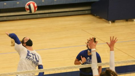 Eastern senior Laurel Bailey (left) attempts a kill during an intrasquad scrimmage at practice Thursday afternoon. Bailey is in her senior year with the volleyball program.