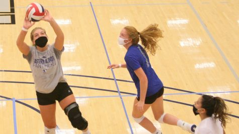 Eastern junior setter Bailey Chandler sets up a teammate for a kill opportunity during a practice on Oct. 8 in Lantz Arena.