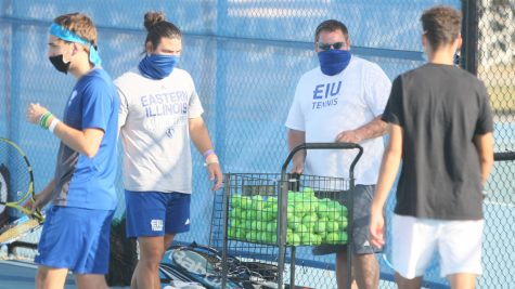 Eastern's Director of Men's and Women's Tennis Chris Tolson (middle) prepares the teams for practice Oct. 8 at the Darling Courts.