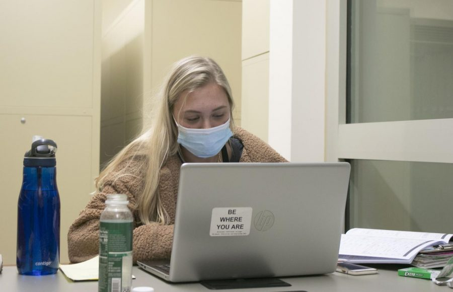 Samy Bushnell, a first-year grad student in communication disorder and science, gets into schoolwork sunday night at Booth Library. Busnell is working on final semester reports for her clients that she has for clinic.