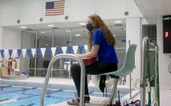 "Megan Donovan, a junior career and technical education major, lifeguards at Padovan Pool Thursday evening. Donovan said she has been lifeguarding since she was 15 but started lifeguarding at Eastern this semester. ""I like knowing that I'm responsible for people's lives,"