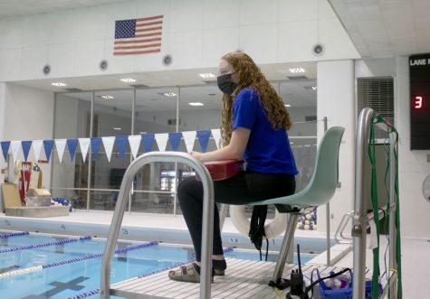 "Megan Donovan, a junior career and technical education major, lifeguards at Padovan Pool Thursday evening. Donovan said she has been lifeguarding since she was 15 but started lifeguarding at Eastern this semester. ""I like knowing that I'm responsible for people"