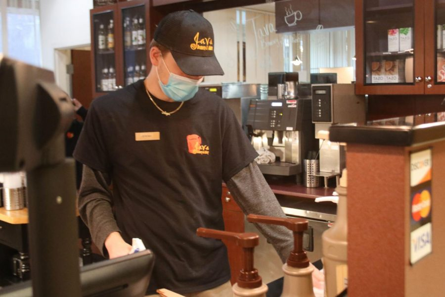 """Jeremy Bragg, a freshman majoring in accounting, cleans at Java in the Martin Luther King Jr. University Union. Work has been slow lately. Since [Thanksgiving] break campus has been pretty empty,"""" Bragg said."""
