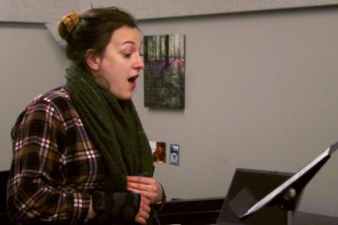 Christina Peter, a voice performance grad student, sings in Dounda Hall practice room Monday evening. Peter said she was practicing her friend