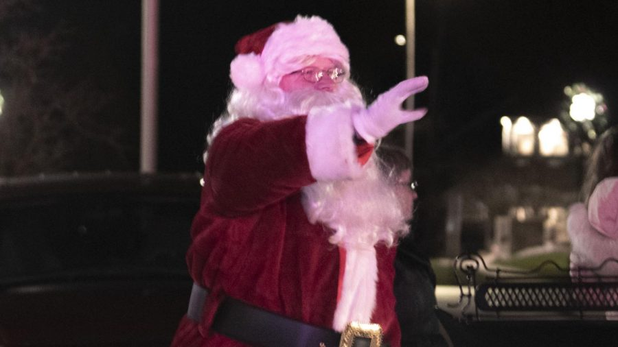 Santa Claus waves goodbye as cars reach towards the end of Christmas in the Heart of Charleston parade Saturday evening. This year, Christmas in the Heart of Charleston had a drive-through parade where cars entered on 7th Street and drove by parade floats.